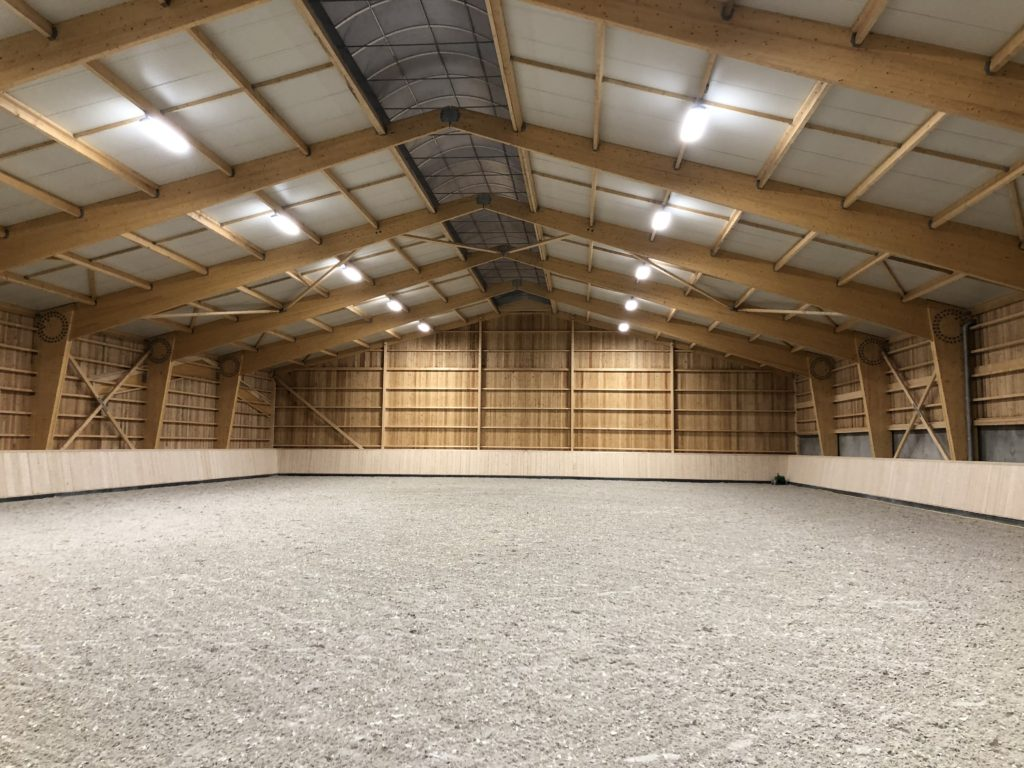 Stables Pascal LEBAS : indoor horse arena lighted by PROXIMAL